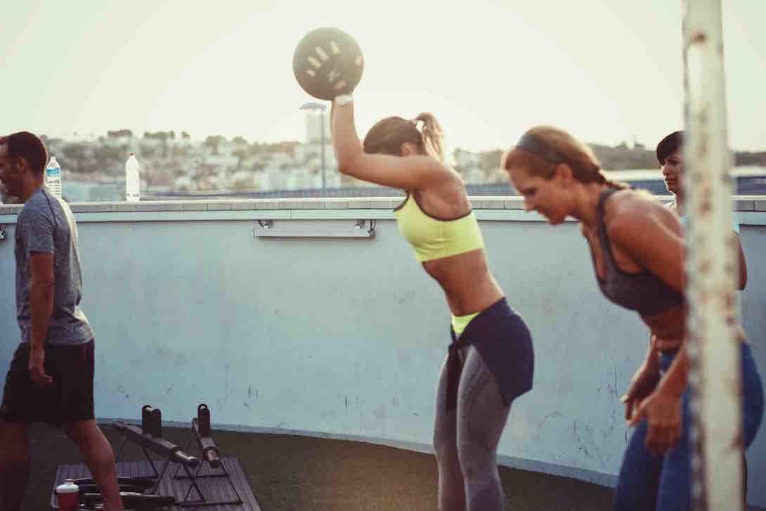 female using medicine ball - UP