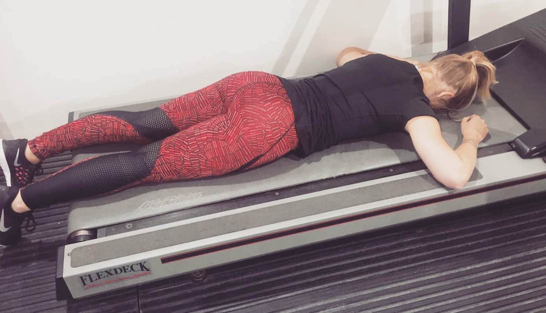 female exhausted after personal training - UP