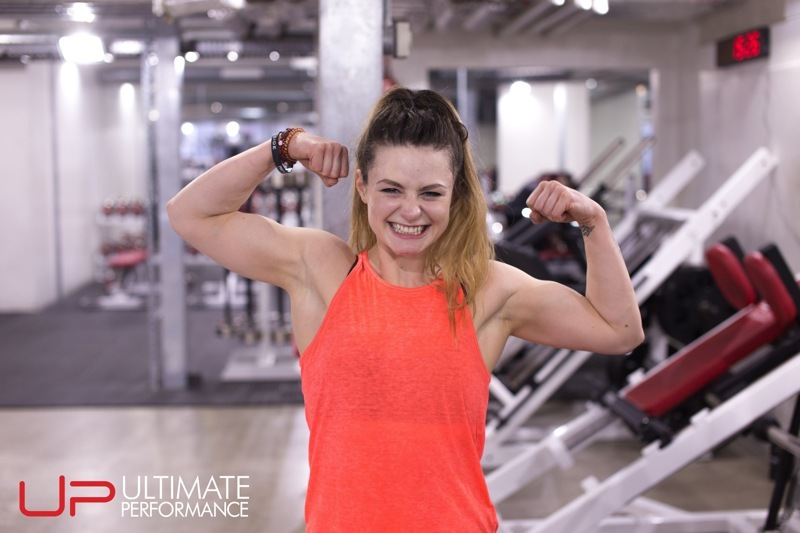 Jenny flexing biceps