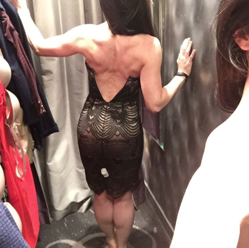 Victoria Ferris trying on clothes