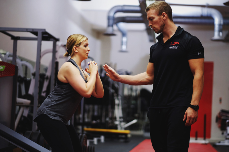 Luke training Morgan, female personal training client