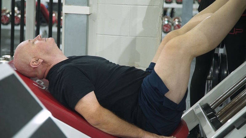 male using leg press - UP
