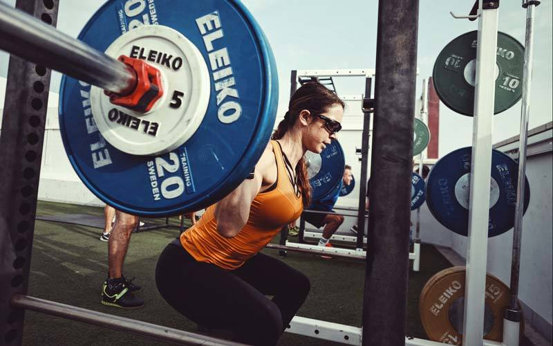 Woman Heavy Squatting UP